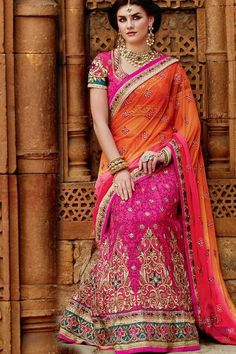 Tussar silk and premium net lehenga saree with gold embroidery and hand-worked lace and patches at bottom. Comes with heavily hand-worked and embroidered pure dupion blouse.Tussar silk, premium net and pure dupion. -www.cooliyo.com