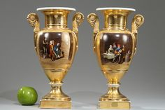 Early 19th century Empire pair of porcelain baluster-shaped vases with two gold tones and polychromatic decoration of interiors scenes in the taste of Dutch painting, with women and men...