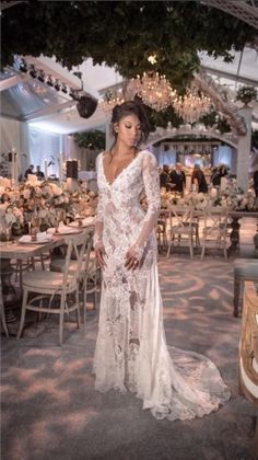 Eniko Parrish wore a custom Vera Wang French Chantilly lace wedding gown with long sleeves to her 2016 wedding to Kevin Hart.