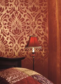 This exotic #bedroom was created using #red #Tikkurila Feelings Interior Paint, Passion stencil, and #gold Taika glaze.
