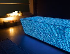 """""""Opus One"""" is a photoluminescent mosaic by Lucedentro. Mosaic consist on little glass tiles mixed with photoluminescen pigments. It express light in different colours. Bathtub Lighting, Opus One, Shower Backsplash, Double Sink Bathroom, Blue Bath, Master Shower, Room Tiles, Tile Installation, Glass Mosaic Tiles"""