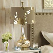 Our exclusive lamp features a champagne gold glass base in a genie shape, with a gold-lined, taupe fabric shade embossed in reflective gold-colored leaves. All so you can bring the gilded age in Lampe Decoration, Decoration Design, Lamp Makeover, Room Lamp, Gold Glass, Glass Table, Lamp Shades, Lamp Light, Gold Leaf