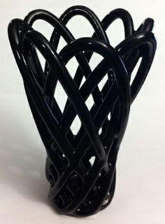 Jason Goodman designed and 3D printed a vase in gloss black ceramics.