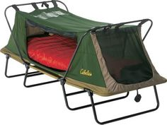 Cabela's Deluxe Tent Cot – Single I could camp in this thing I'm not touching the ground and I can zip up lol