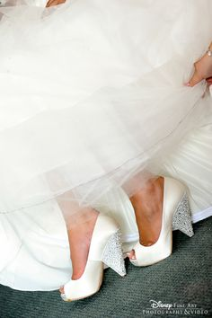 Ivory satin pumps with a platinum glitter covered heel