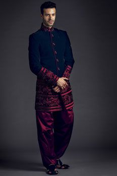 Velvet indo-western sherwani with patiala embellished with resham and moti work.