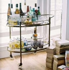 The secret to the Holidays is a well-stocked bar! Get tips and tricks for creating your own ultimate home bar for the holidays, from Indeed Decor. Brass Bar Cart, Gold Bar Cart, Bar Cart Styling, Bar Cart Decor, Mini Bars, Bar Redondo, Bar Deco, Bar Trolley, Drinks Trolley