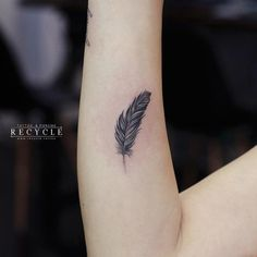 20 Whimsical Feather s CafeMom feather tattoo - Tattoo White Feather Tattoos, Feather Tattoo Wrist, Peacock Feather Tattoo, Feather Tattoo Design, Tribal Feather, Wrist Tattoos For Women, Tattoo Designs For Women, Mandala Design, Mandala Arm Tattoo