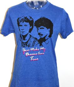 "Hall & Oates are the most famous singer/songwriting duo of the 1980s, and they are prominently featured, along with the title to one of their classic hit songs, ""You Make My Dreams Come True,"" on this vintage inspired blue tshirt. Made with a 60/40 cotton poly blend, this funny and fashionable fitted Hall & Oates tee is bound to get you attention and is a must have if you grew up listening to the famous Hall and Oates duo."