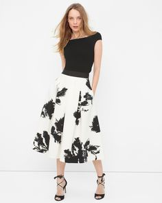 $140 Prepare to be charmed by our swingy, full skirt boasting an abstract print. Its black ribbon waistband not only anchors the brushstroke florals, but it also visually contours the waist. We like pairing this midi skirt with a simple top and strappy heels for a more elongated silhouette.  Floral print full skirt sits above the natural waist  Side zip On-seam pockets  Polyester/spandex. Machine wash, cold.