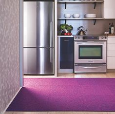radiant orchid trend | Radiant Orchid Carpet It is different to see this color in the kitchen but it works very well with the grey of the stainless steel appliances.