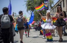 """The iconic LA Pride Parade — a decades-old celebration of the LGBT community — will be replaced this year with a protest march, according to the event's organizers. In lieu of the colorful floats that typically roll down Santa Monica Boulevard in West Hollywood, this year's June 11 event will simply consist of """"people moving through the streets"""" marching for human rights, said Brian Pendleton, a board member for Christopher Street West, the nonprofit that organizes the annua..."""