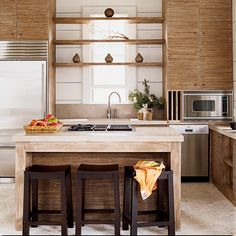 Beachy BoHo Interiors --- Visual Interest - Wood softens the lines in this modern kitchen, and warm tones balance the industrial appearance of limestone countertops and stainless appliances. Tropical Kitchen, Kitchen Decor, Kitchen Inspirations, Decor, Home, Kitchen Design, Boho Interiors, Kitchen Remodel, Kitchen Renovation