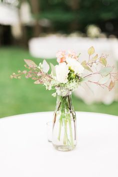 Simple wedding centerpiece idea - floral centerpieces in glass vessels {Jessica Cooper Photography}