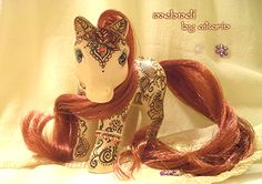 I had ponies like this when I was a kid - just without the henna, which I think looks so lovely though! :)