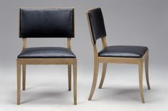 Pair of Henningsen Chairs  Designer:	  Henningsen, Fritz  Producer:	Fritz Henningsen  Year:	'40s  Solid oak with leather seats.
