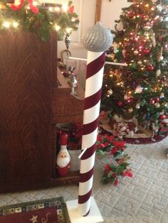 Stocking tree made from cardboard tube ribbon and a large Christmas ornament on top