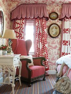 red chair - Hydrangea Hill Cottage....absolutely love the Co-ordinating yet different patterned curtain treatment in this room......quilt patterns.