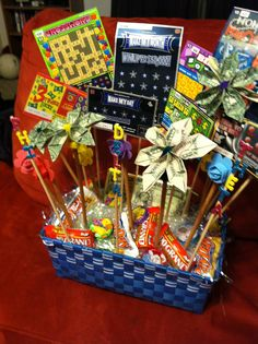 Scratch off lottery ticket basket for silent auction.  Folded money into flowers to add to the appeal.  You can't see the denominations on some of the bills, so it leaves it a mystery!