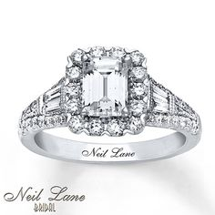 A stellar emerald-cut diamond is framed in lovely round diamonds at the center of this engagement ring from Neil Lane Bridal®. Baguette diamonds adorn each side of the center, with round diamonds flowing along the band of 14K white gold. The ring has a total diamond weight of 1 7/8 carats. Neil Lane's signature appears inside the band. Diamond Total Carat Weight may range from 1.83 - 1.94 carats.