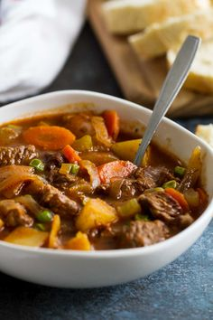 This Classic Homemade Beef Stew Recipe is the perfect comforting stew for chilly nights or Sunday dinners. This stew is filled with beef, potatoes, carrots, celery and peas for the perfect cold weather meal. #recipe #comfortfood #beef #beefstew