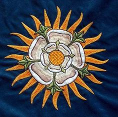 A few days after his father, Richard of York, died in the battle of Wakefield, his son Edward, future Edward IV, saw in the sky two bright suns. He assumed it as a signal of victory. That´s why the York white rose is rounded by sunbeam.