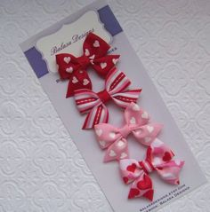 Boutique Pink and Red Valentine Hearts Petite Bow Set. $5.00, via Etsy.