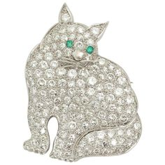 1930s Emerald Diamond Platinum Figural Green-Eyed Kitty Cat Brooch | From a unique collection of vintage brooches at https://www.1stdibs.com/jewelry/brooches/brooches/