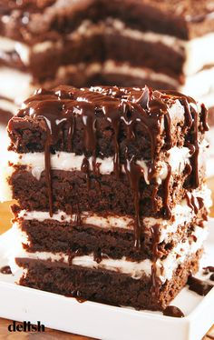 Brownie Lasagna is the most decadent dessert we've EVER made. Get the recipe at Delish.com. #recipe #easy #easyrecipes #delish #dessert #dessertrecipes #baking #brownies #lasagna #creamcheese #frosting #desserts #chocolate