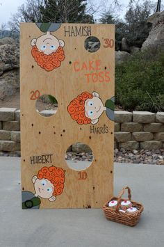 BRAVE THEME: The beanbag toss featuring the faces of Merida's three brothers