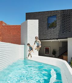 Make Architecture has added a brick extension to a Victorian cottage in Melbourne, which curves around a secluded courtyard
