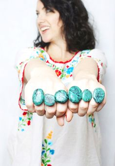DIY faux turquoise rings using rocks and marbled nail polish