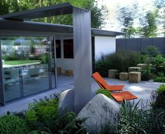 I always want a garden to be intriguing and engaging and if I can make people stop and think then I consider it a success. Here the voids within the...