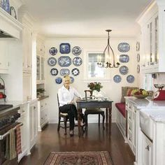 Great galley kitchen design - love the built in seat and table at the end