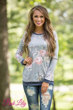 If you love our Not An Average Girl Sweatshirts in Coral and Grey, you're sure to love this stunning blouse! This long sleeved blouse has so much floral print that our hearts can hardly stand it!