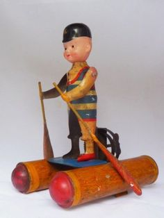 Antique 1930's Japanese Wind up Tin and Celluloid Toy  Boy in rowing a raft