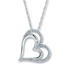 Diamond Heart Necklace -A diamond-decorated heart wraps around a smaller sterling silver heart in this romantic necklace for her. The pendant is suspended from an 18-inch rope chain fastened with a spring clasp. The necklace has a total diamond weight of 1/4 carat. Diamond Total Carat Weight may range from .23 - .28 carats.