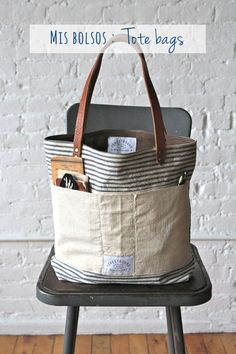 era Ticking Fabric Tote Bag - FORESTBOUND Very cute and vintage like.love the pockets in the front. Sacs Tote Bags, Fabric Tote Bags, Diy Tote Bag, Tote Purse, Camo Purse, Lv Bags, Diy Sac, Sacs Design, Ticking Fabric