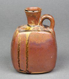 """Lot 4, A John Leach Muchelney Pottery slip glazed bottle impressed marks 5"""", sold for £65"""