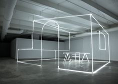 Installation comprising neon tubes sculpted into a room.
