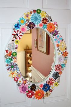 Mirror embellished with vintage enamel flower brooches