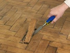 Learn how to patch and repair a damaged parquet floor.