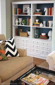 10 Things To Do with a Quart of Paint • Great Ideas & Tutorials! Including this idea of painting the backs of bookshelves to add a little pop - from 'emily clark'.