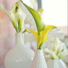 Simple and chic white lily centerpieces from a casual backyard wedding