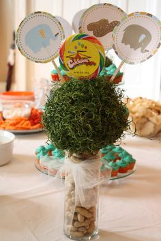 Moss ball decoration with peanuts at the base.