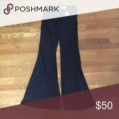 Black palazzo pants NOT YOGA PANTS! They are more formal with a thicker material! New with tags originally $67.99 from a local boutique. Inseam is 33.5 inches. Waist is 30 inches Fitted. Pants Boot Cut & Flare