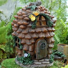 Fairy Homes and Gardens - Large Pinecone Design Fairy House with Hinged Door, $45.95 (https://www.fairyhomesandgardens.com/large-pinecone-design-fairy-house-with-hinged-door/)