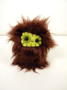 Cute monster stuffed animal.
