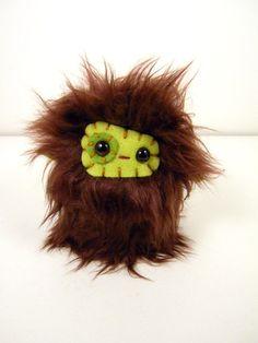 Cute monster stuffed animal.