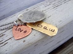 faith hope and love....hand stamped pendant in silver, copper and brass...Etsy shop beadsoul ... awesome jewelry!! Love it!!!